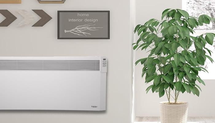 A tesy wall heater next to a plant