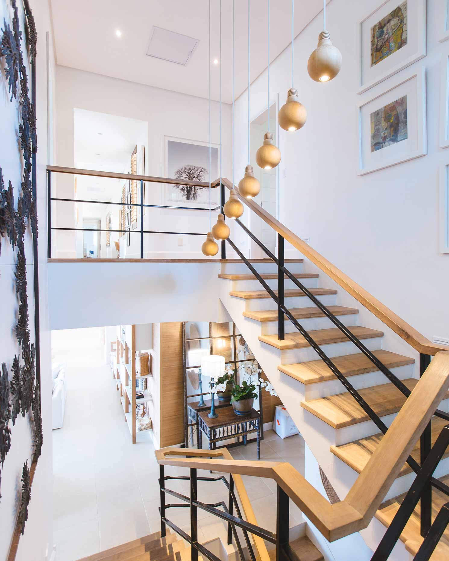 Two staircases anchored by lights in a modern house