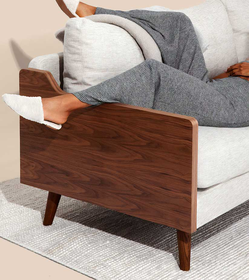 Modern armchair with womans legs hanging over the side